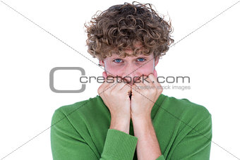 Anxious casual man looking at camera