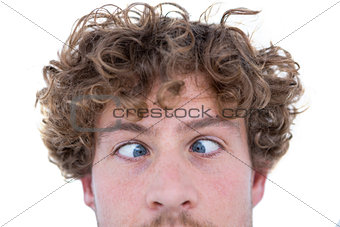Casual man grimacing in front of camera