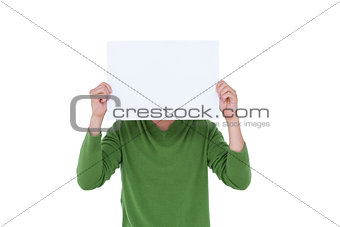 Casual man hiding his head with blank paper