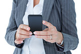 Happy businesswoman calling with smartphone