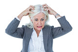 image of stressed businesswoman with hands on her head