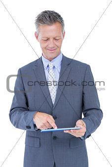 Smiling businessman against a white background