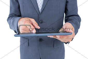 Close up view of businessman using tablet computer