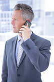 Anxious businessman on the phone