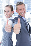 Two business colleagues giving thumbs up