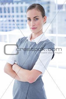Focused businesswoman looking at the camera