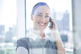 Smiling businesswomen talking on the phone