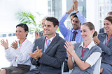 Business team applauding during conference