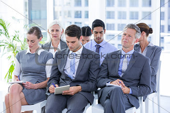 Business team taking notes during conference