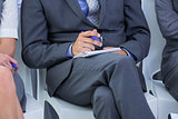 businessman taking a note during a meeting