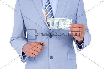 businessman burning a dollar banknote