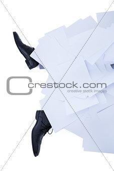 businessman burried under piece of paper