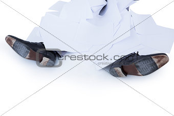businessman burried under piece of paper