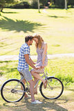 Young couple on a bike ride in the park