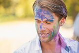 Young man having fun with powder paint