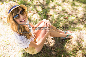 Smiling blonde relaxing in the grass
