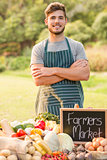 Handsome farmer standing arms crossed