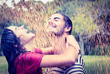 Cute couple hugging under the rain