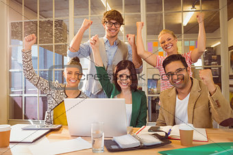 Group of young colleagues using laptop
