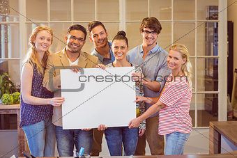 Business team holding a white cardboard