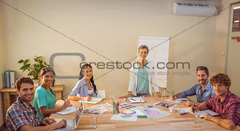 Casual businesswoman giving presentation to her colleagues
