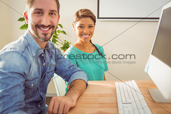 Portrait of two colleague using a computer