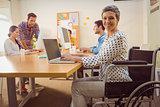 Creative casual businesswoman in wheelchair