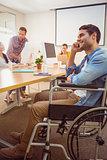 Creative businessman in wheelchair on the phone