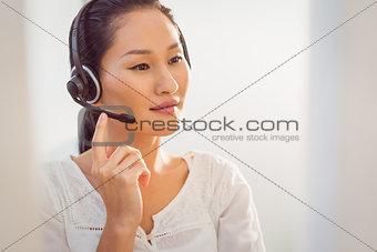Call centre representative using headset