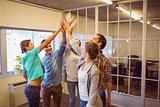 Creative business team raising their hands