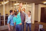 Creative business team raising their hands