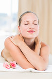 Peaceful blonde lying on towel