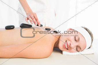 Beautiful blonde enjoying a hot stone massage