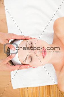 Beautiful blonde getting a head massage