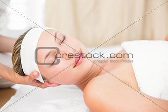 Beautiful blonde lying on massage table