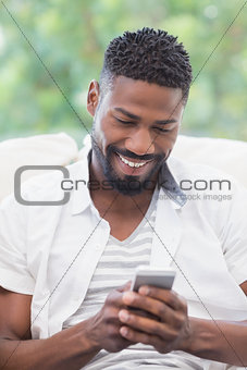 Casual man using his smartphone