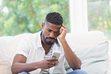 Worried man looking at his phone