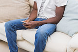 Man using his phone on couch