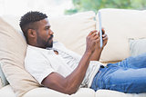 Man using his tablet on couch