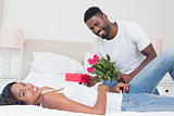 Romantic man giving roses to partner