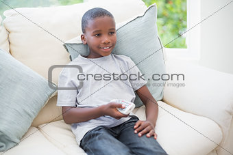 Little boy watching tv on the couch