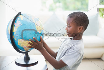 Little boy looking at the globe