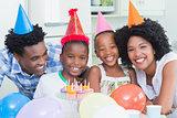 Happy family celebrating a birthday together