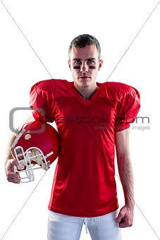 A serious american football player looking at camera