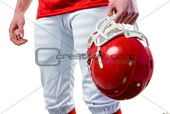 An american football player taking his helmet on her hand