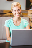 Happy pretty blonde using computer