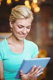 Pretty blonde using tablet computer
