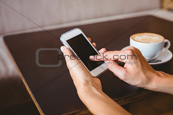 Hand of woman holding smartphone