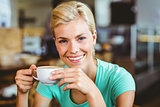 Pretty blonde holding cup of coffee
