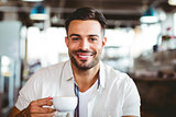 Handsome man having a coffee